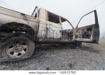 Low And Wide Shot Of A Burnt Out Pick Up Truck