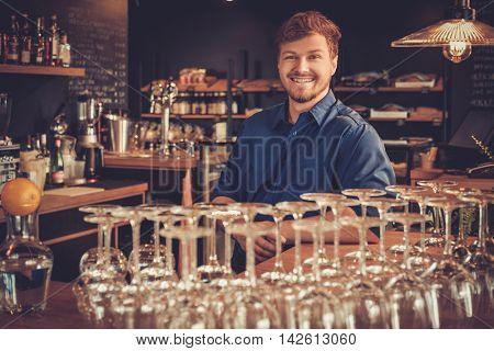 Barman having fun at bar counter in bakery.