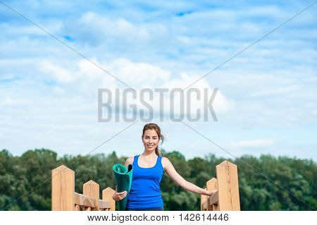 Young Woman Practicing Advanced Yoga Fitness Workout02