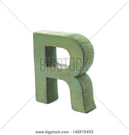 Single sawn wooden letter R symbol coated with paint isolated over the white background