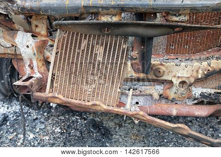 Close Up Detail Of Radiator And Engine Bay Of Burnt Out Car