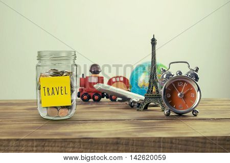 Planning summer vacationTravel and tourism concept with souvenirs from around the world.Vintage effect filter style pictures