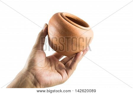 Men's hand holding Earthenware Jur isolate on a white background