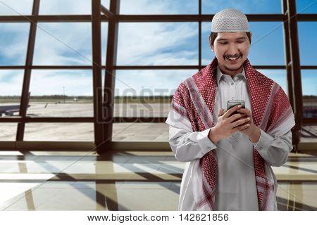 Asian Man Muslim On Airport