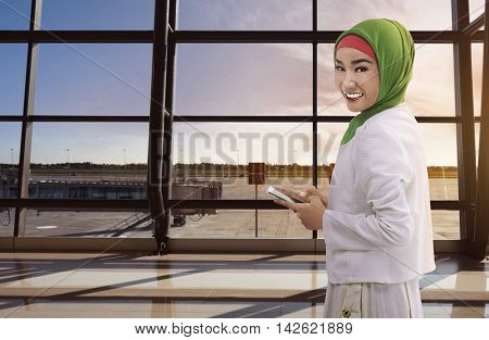 Asian Woman Muslim Holding The Phone