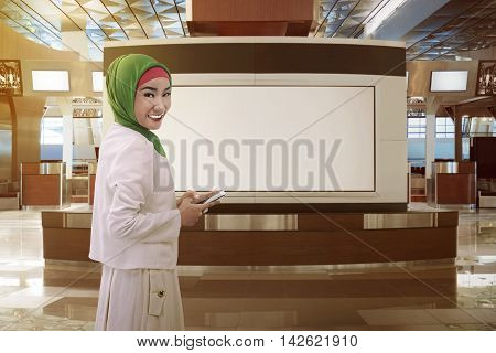 Asian Women Dressed In Hijab On Airport Lobby