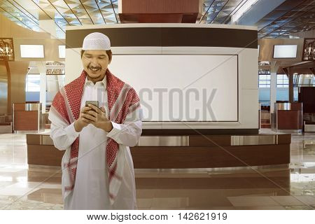 Asian Muslim Man Holding Phone