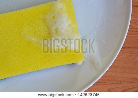 scrub sponge wash on the white dish