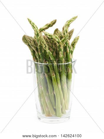 Glass filled with the multiple cultivated green asparagus spears isolated over the white background