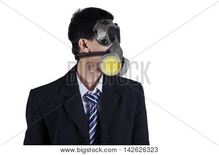 Photo of a young businessman wearing a gas mask and formal suit in the studio isolated on white background