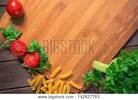 Tomatoes, Basil And Pasta On Wood Table