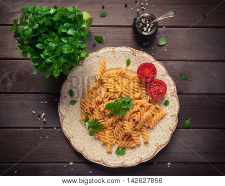 Fusilli Pasta In Tomato Sauce. Rustic Style
