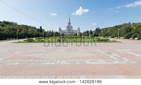 Moscow - August 11 2016: Beautiful Moscow State University named after Lomonosov on the Sparrow Hills and the alley leading to it August 11 2016 Moscow Russia