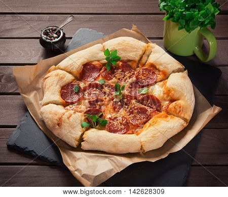 Homemade Pepperoni Pizza On Wooden Background