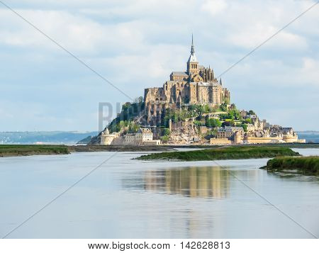Couesnon river and Mont Saint-Michel - tidal island town and abbey. France
