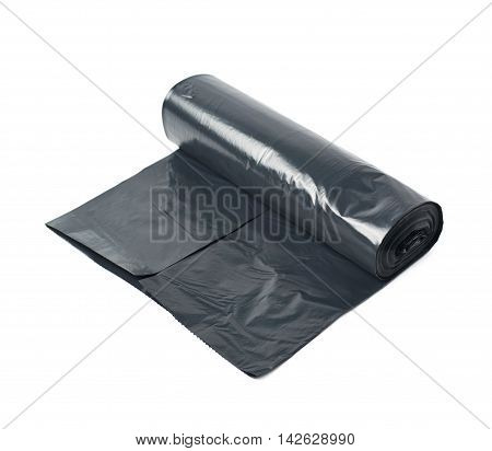 Black plastic polyethylene trash bag roll isolated over the white background