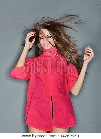 Confused Young Woman With Long Hairs Flying Upwards Dressed In Pink Blouse, Ring Flash Studio Portra
