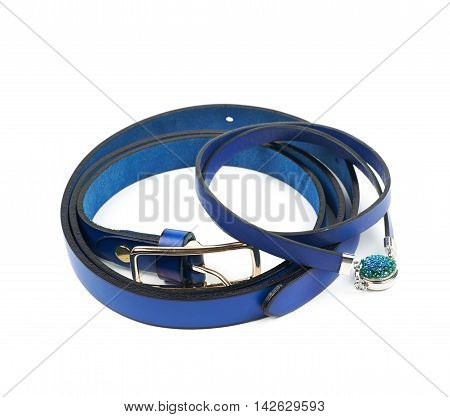 Blue belt and lether necklace composition isolated over the white background
