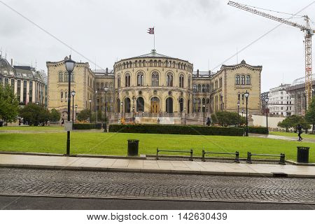 OSLO, NORWAY - JULY 1, 2016: This is the building of the Parliament of Norway which was built in the Neo-Romanesque style in 1866 designed by Swedish architect E. Langlet.
