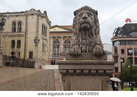 OSLO, NORWAY - JULY 1, 2016: This is one of the two stone lions that adorn the entrance to the Norwegian Parliament.