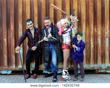 UKRAINE, ODESSA - August 13, 2016: Cosplayer girl in Harley Quinn costume and cosplayer men in Joker and Boomerang costumes during Fan Expo Odessa, Comic Con