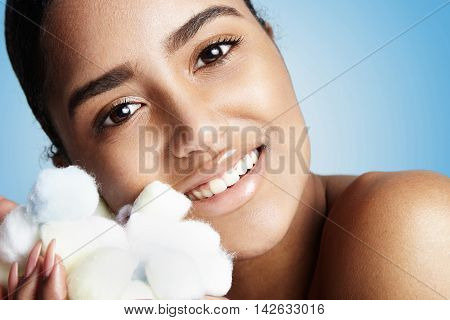 Woman's Portrait With A Soft Cotton Balls In Hands Clasp To A Cheek