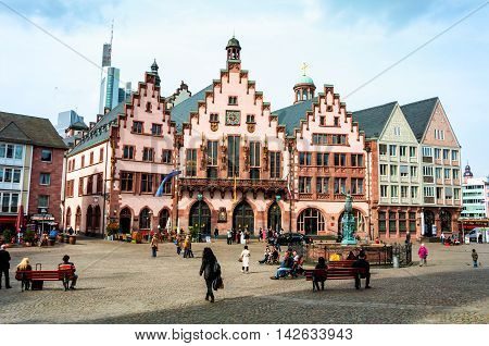 FRANKFURT GERMANY - MARCH 21 2014: Old medieval building at Romerberg square. It is made in middle-age style in Altstadt - a historical center of the city which existed from the 8th century