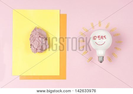 great idea concept with crumpled colorful paper and light bulb. Creative brainstorm concept business idea innovation and solution creative design.