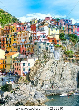 Colorful traditional houses on a rock over Mediterranean sea t, Manarola, Cinque Terre, Italy