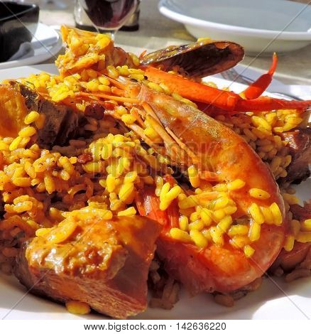 Spanish paella with seafood and meat. Traditional spanish meal.