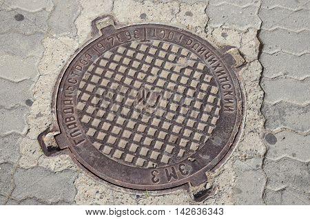 Chita RU - Jul.172014: Cast iron manhole cover of urban sanitation in tha city of Chita Russia