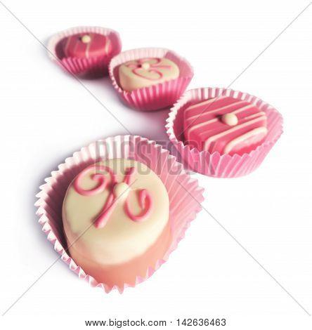 Petit Four or chocolates isolated on white background.