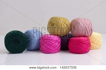Colorful balls of woolen yarn isolated on white background