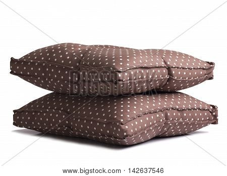 Polka dot brown cushions isolated on white background