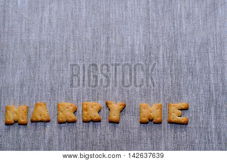 'Marry me' phrase made of salty small crackers