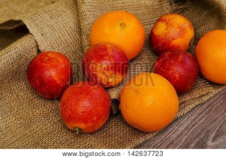 Ripe cicilian blood oranges on white background