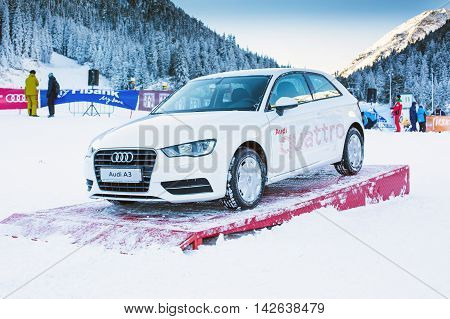 Bansko, Bulgaria - December 12, 2015: Audi car prize at opening of ski season Bunderishka polyana, people at Bansko ski resort