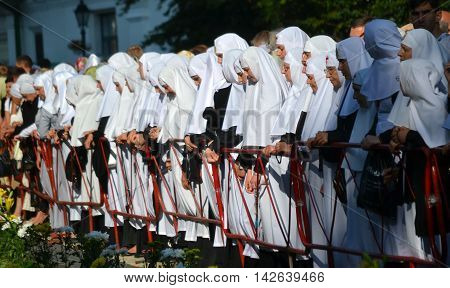 Kiev Ukraine celebration liturgy in honor of the baptism of Rus in Kiev Pechersk Lavra - 27 July 2013 -: Sisters of Mercy standing near the fence head bowed