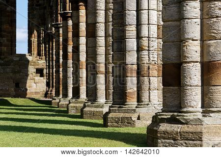 WHITBY ENGLAND - AUGUST 12: Stone columns within the ruins of Whitby Abbey. In Whitby North Yorkshire England. On 12th August 2016