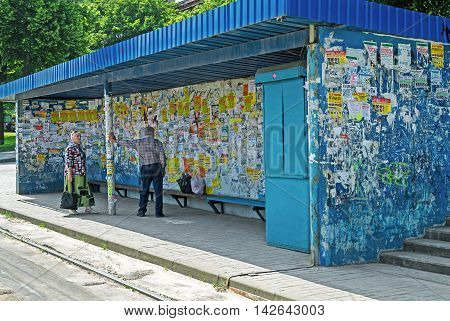 Dnepropetrovsk Ukraine - June 03 2016: Public transport stop taped private ads