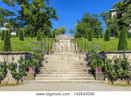 Zurich, Switzerland - 14 August, 2016: view in the Rechberg Garden. Rechberg Garden is a public park on the compound of Zurich University, it serves the general public and the students as place of recreation.