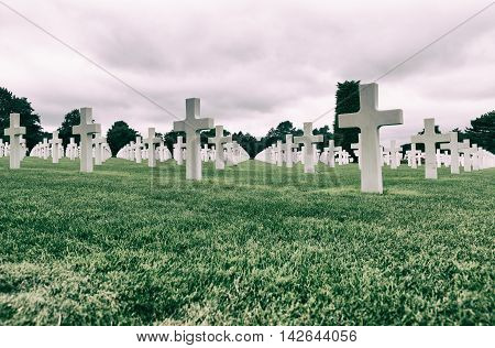 White crosses in American Cemetery Coleville sur-Mer Omaha Beach Normandy France.