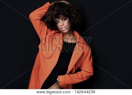 Fashionable Woman In Orange Coat.