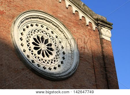 Round window at Church. The element of religious architecture in Italy.