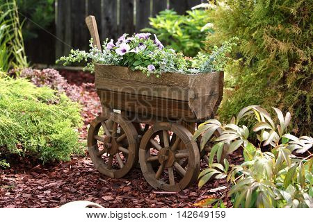 Garden - Flowerpot in the form of the old cart.