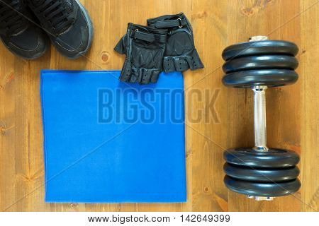 towel with dumbbells for sports in the hall