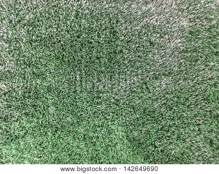 Closeup surface abstract fabric pattern at the dark green fabric carpet at the floor of house textured background