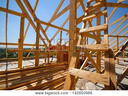 frame construction residential building roof sunny day