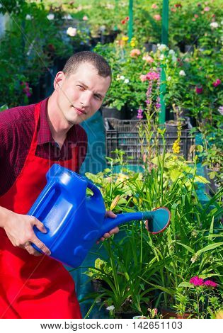 a man in the garden with watering can
