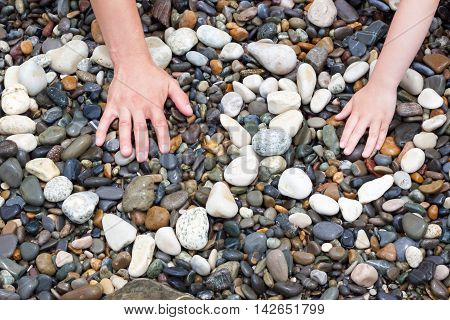 two hands in an embrace hearts, stones